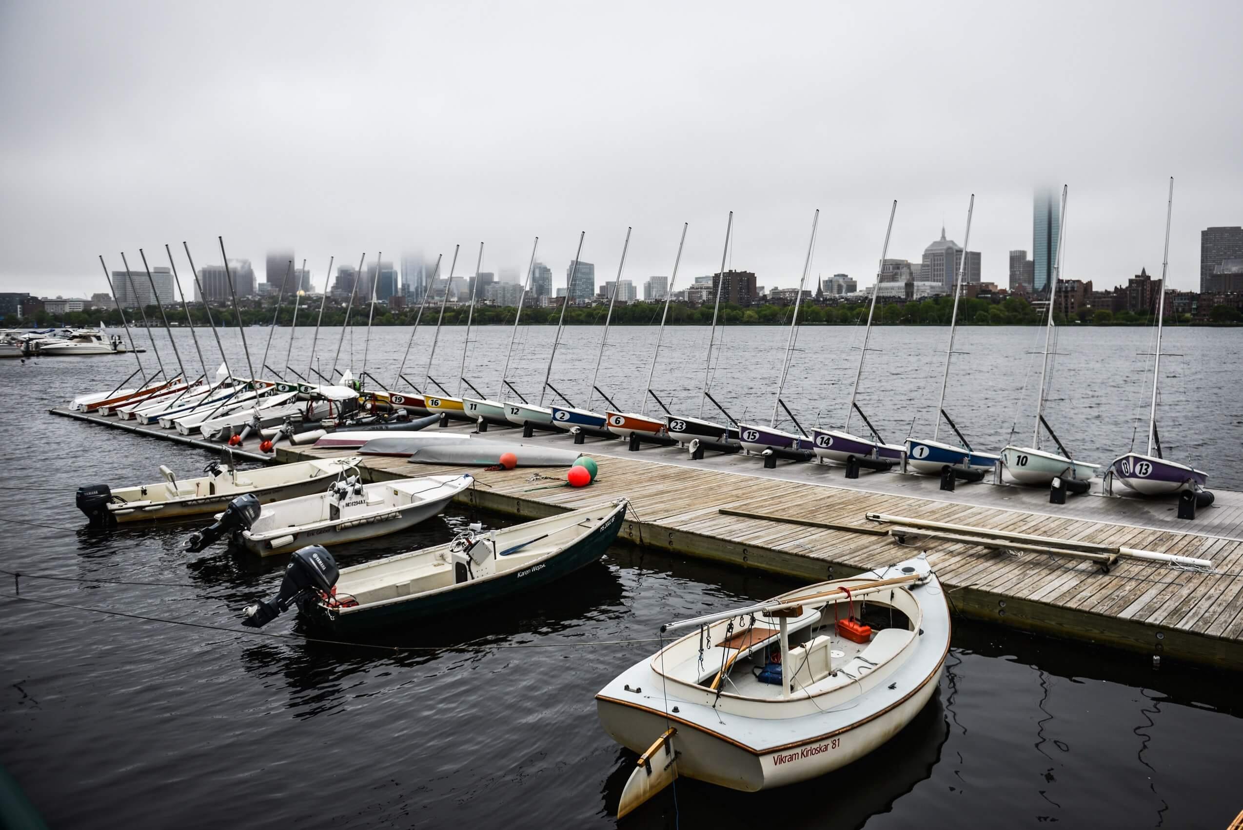 Fiberglass composite boats near a dock in Boston