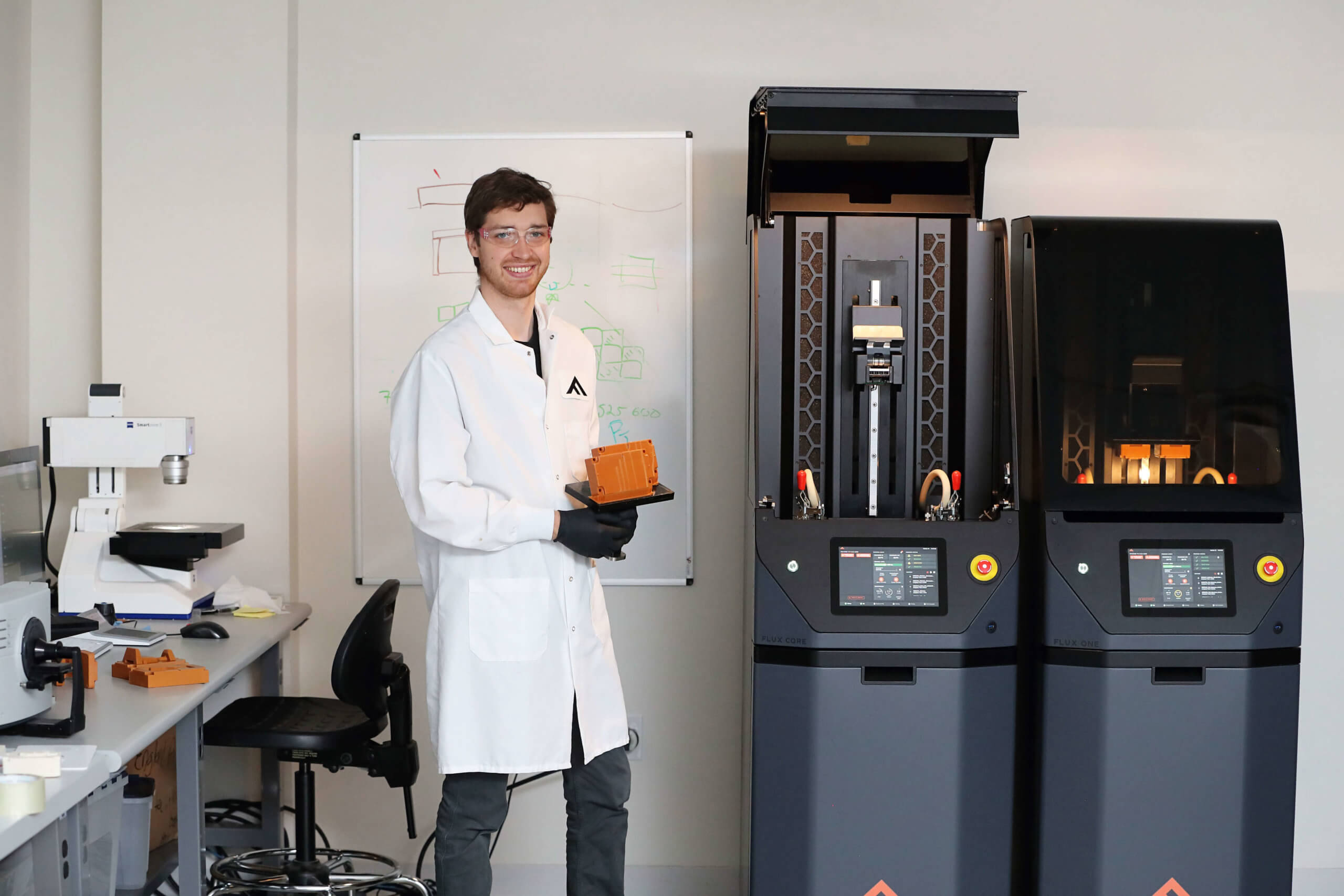 Scott in front of printers in lab